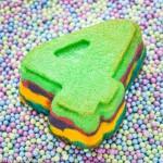 Cupcakes van het cijfer 4 met gekleurde ondergrond